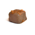 <big><b>Knusper Nougat</b></big><br>Mandelnougat mit Cookies Stueckchen <br>und Edel Vollmilch Schokoladen Ueberzug.<br>'Ohne Alkohol'